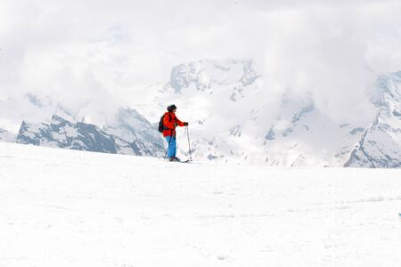 child skiing on a snowy mountain slope, Caucasus, people, skiers,