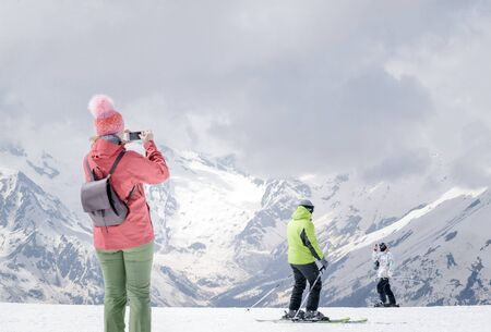 people skiers in the Caucasus mountains winter snow