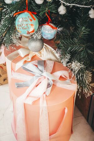 gifts under Christmas tree with decorations, boxes,