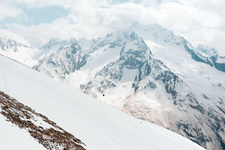 Caucasus mountains in winter, landscape,  peaks and slopes covered with snow,