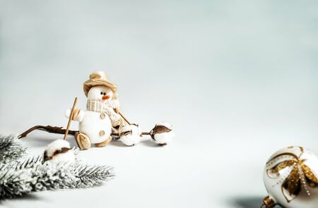 snowman, cotton branch, green spruce branch, silver Christmas ball, on a gray background, Christmas decor, Stock fotó