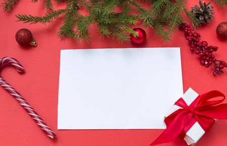 blank sheet of paper on red background, Lollipop, gift, spruce branch,  Lollipop, red balls, cone,,