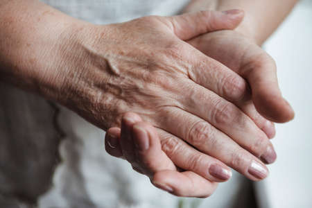 mother s hands, hands of an adult, old woman close up,