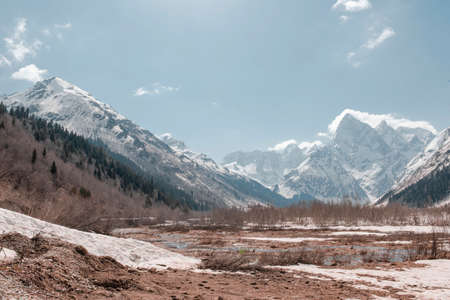 mountain landscape with snowy peaks and a valley on a Sunny winter day, Caucasus