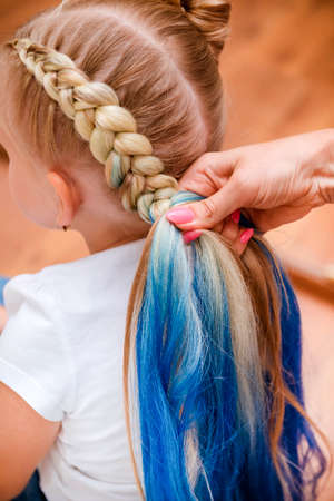 blonde girl braids with blue hair, beautiful hairstyle