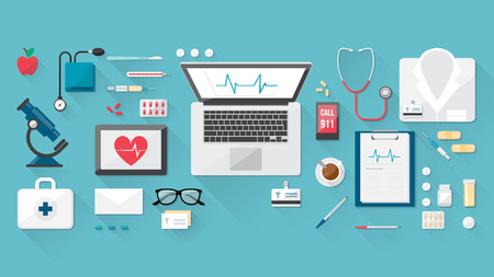Doctor's desktop with medical healthcare tools and equipment, laptop, tablet and phone