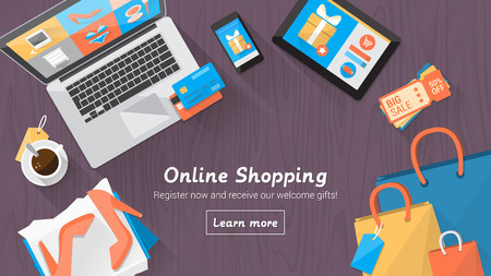 e shopping: Online shopping concept desktop with computer, table, shopping bags, credit cards, coupons and products