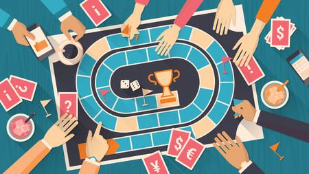 jeu: Un groupe de gens en jouant avec un jeu de plateau