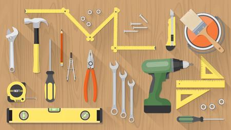 Zimmerei und Renovierungs-Tools auf einem Holztisch Draufsicht