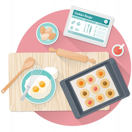 kitchen table top: Pastry cooking with tablet