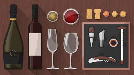 Wine tasking toolkit for wine makers, sommelier and experts, including wine glass, bottles, corkscrews and assorted objects on wooden background