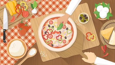 Chefs koken een heerlijke traditionele groenten pizza, handen werken bovenaanzicht met keukengerei, ingrediënten en houten werkblad