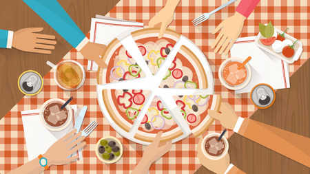 tables: People having dinner together and sharing a huge pizza with drinks, hands top view