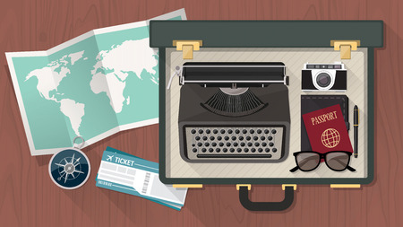 bloggers: Reporter and writer vintage suitcase open with a typewriter room world map passport plane tickets and compass top view