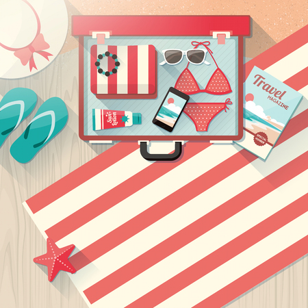 bikini top: Holidays on the beach concept, fashion female accessories in a open suitcase, bikini, sunglasses, hat and mobile phone in an open vintage suitcase on wooden flooring and sand
