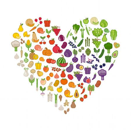 Les légumes et les fruits dans une forme de coeur sur fond blanc