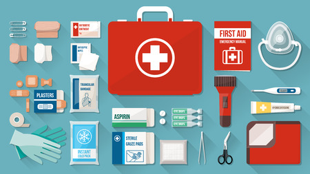 at first: First aid kit box with medical equipment and medications for emergency, objects top view