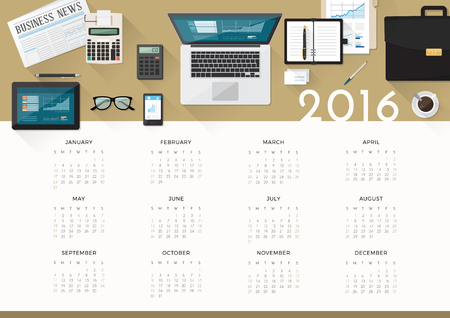 financial year: Business calendar 2016, desktop top view with laptop and working tools
