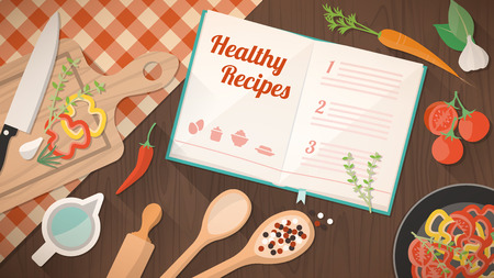 ingredients: Healthy recipes cookbook, kitchen utensils and ingredients on the kitchen table, food preparation and learning concept