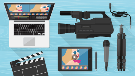 Video making, shooting and editing with professional equipment on a wooden desk, flat lay