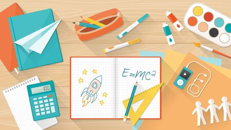 student with books: Creative young student desktop with notebook, books and colors, education, learning and childhood concept