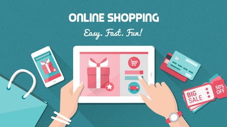 eshop: Online shopping and delivery concept, woman buying fashion products from an e-shop using a digital touch screen tablet, flat lay