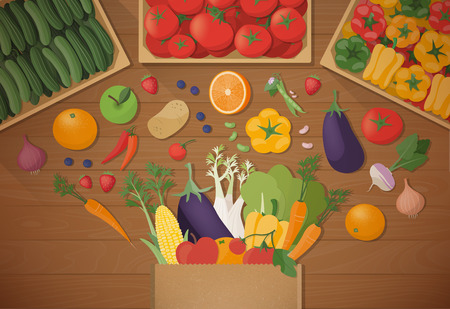 Explosion of tasty freshly harvested vegetables in a paper shopping bag, healthy eating and agriculture concept, vegetables crates on top