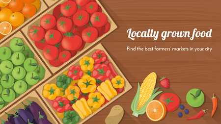 crops: Colorful freshly harvested vegetables in crates at the farmers market, locally grown food and healthy eating concept banner