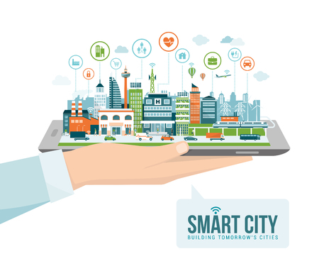 Mano que sostiene una tableta digital con una ciudad inteligente contemporánea y aplicaciones de iconos: realidad aumentada y conexión a internet de las cosas concepto