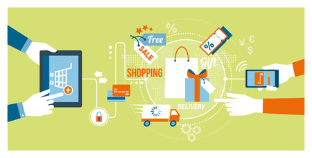 Online shopping and technology concept: users buying products and gifts online using a tablet and a smartphone