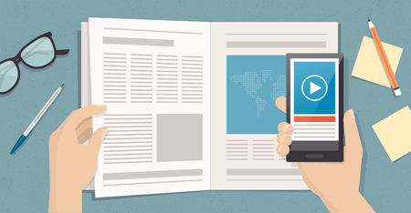 Man reading a magazine and viewing augmented reality content and news on a page using a smartphone, technology and communication concept