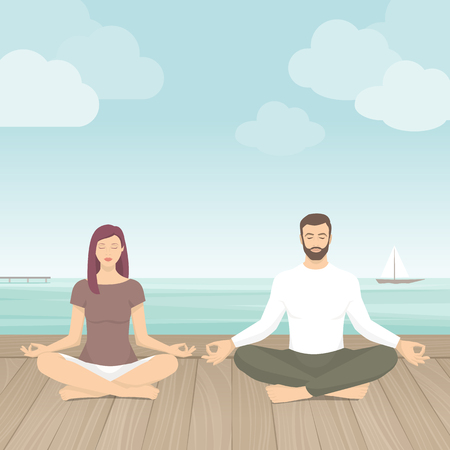 Couple practicing meditation outdoors, they are sitting in the lotus position next to the sea, yoga and self consciousness concept
