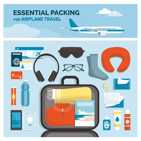 Emballage essentiel pour les voyages en avion : vêtements et accessoires essentiels dans un sac à main, concept de vacances et de tourisme, mise à plat