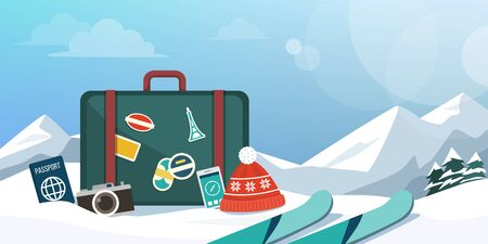 Tourist exploring mountains at winter and skiing, suitcase and travel equipment on the snow