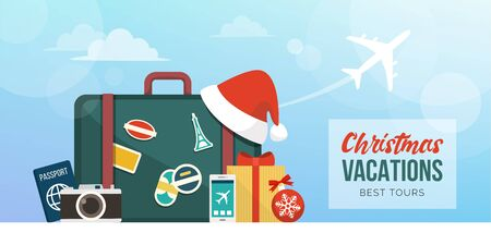 Christmas holiday vacations around the world: suitcase with travel and festivity items
