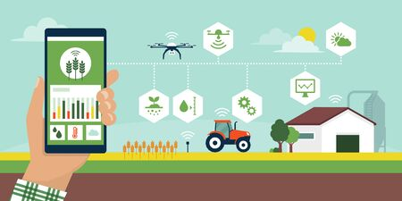 Farmer managing his industrial farm using an app on his smartphone, smart agriculture