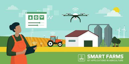 Agricultrice gérant sa ferme industrielle avec une application mobile sur sa tablette, IOT et concept d'agriculture intelligente