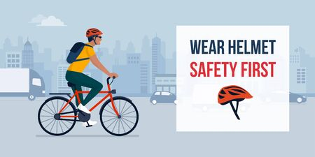 Wear helmet when riding a bike, man cycling in the city street wearing a helmet, safety concept
