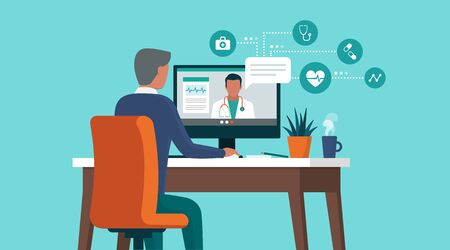 Senior man consulting a doctor online using his computer, telemedicine and online doctor concept