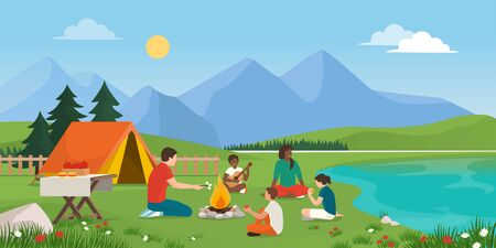 Happy family camping together in nature, they are sitting around a fire, eating together and having fun