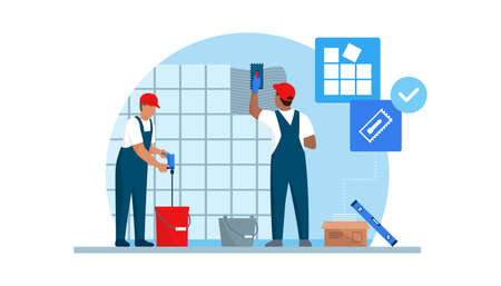 Professional tilers installing tiles on a wall using professional tools, home renovation concept