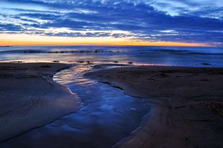 Dawn at the Ladoga. The creek flowing in waters of the Ladozhskoye lake. Stock Photo