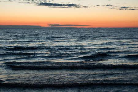 leningrad: Waves on the shore of Ladoga lake at dawn. Beautiful sunrise landscape