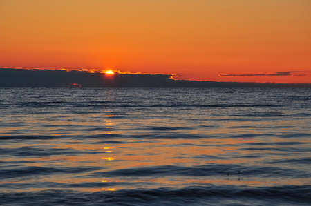 ladoga: Dawn at the Ladoga. The sun rising above the lake reflecting in the waves.