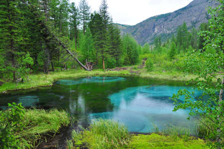 Geyser lake in the forest. Altai, Russia.