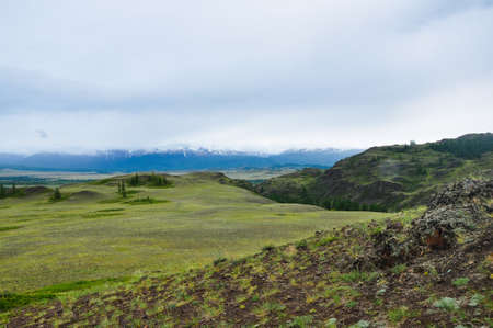 Altai mountains landscape. The mountain range behind the steppe and hills Stock Photo