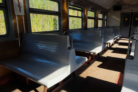 Interior of a suburban electric train in summer day. Saint-Petersburg
