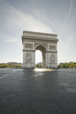 The famous Arc de triomphe in Paris, on the top of Champs Elysees avenue