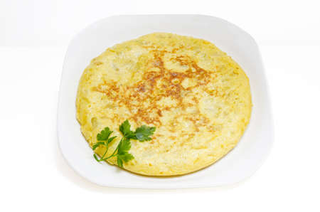 omelette: Spanish cuisine  Potatoes omelet  Slices of Spanish omelet or tortilla de patatas on a white plate with parsley
