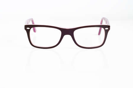 Retro eye glasses on isolated white background photo